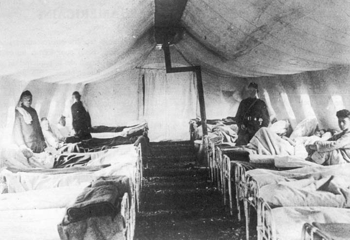 Inside of a recovery tent in an American field hospital. & Antonin Guillot. The American Camp at Allerey (1918-1919). 1999 ...